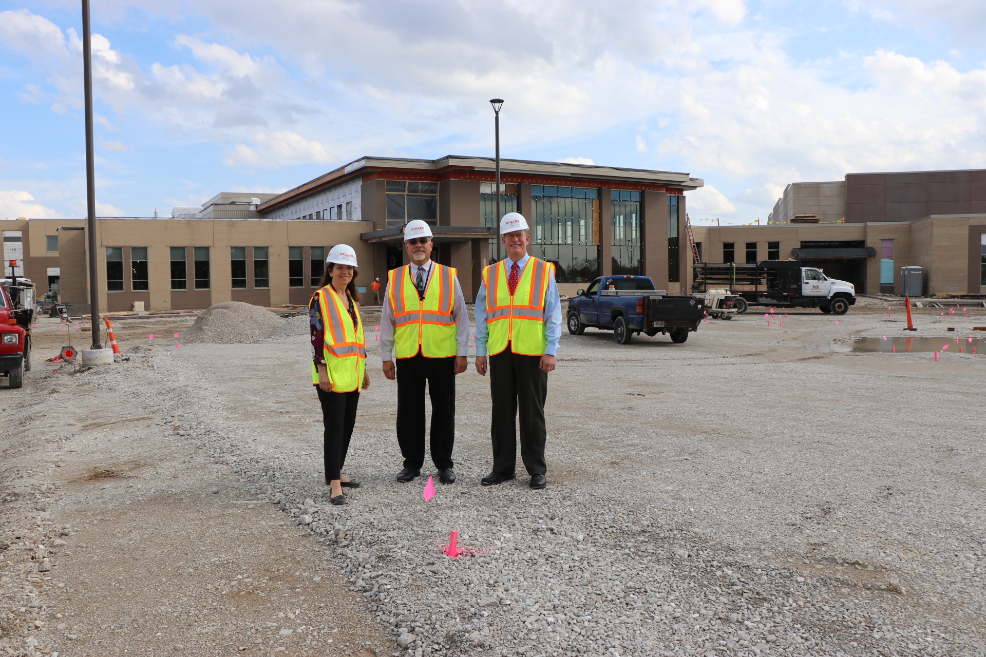 District Administrators in  front of Construction site