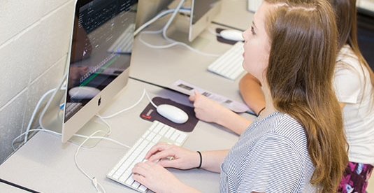 A girls working at her computer