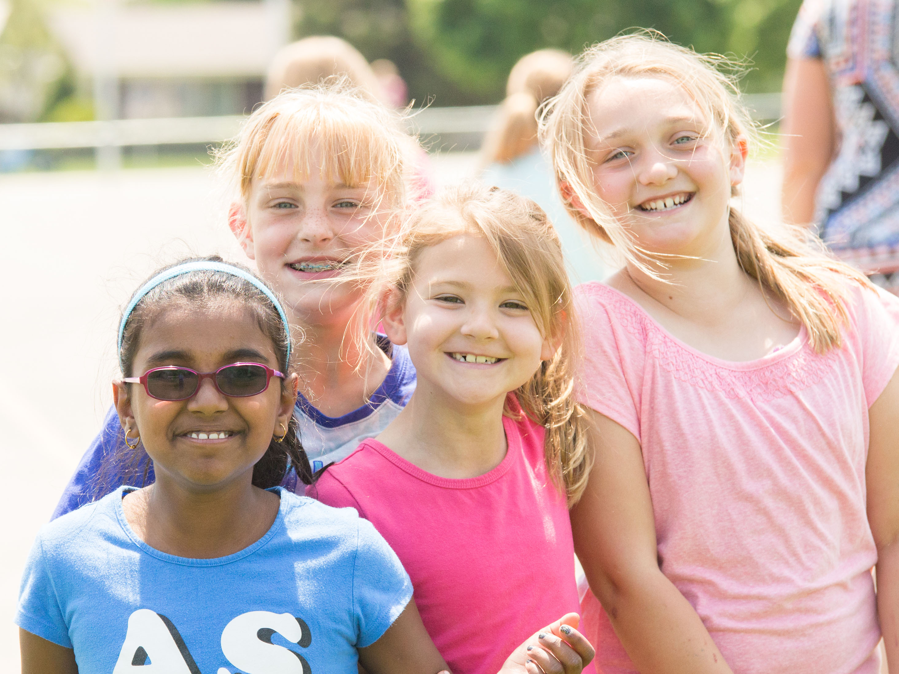 Students Smile Together on Playground